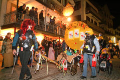 Participants in costumes perform a street procession at the carn Royalty Free Stock Photos