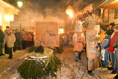 Participants in costumes perform a street procession at the carn Stock Photos