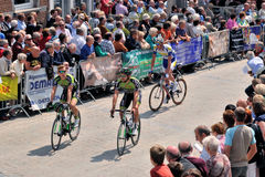 Participants of cycling race cross historical center of Halle Royalty Free Stock Image
