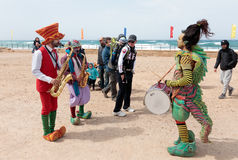 Participants of festival dressed as clowns playing musical instr Stock Image