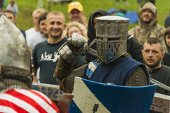 Participants of the festival in knight armor arrange fights Royalty Free Stock Photo
