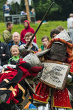 Participants of the festival in knight armor arrange fights Stock Image