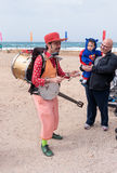 Participants of festival plays musical instruments and shows his Stock Photo