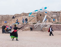 Participants of festival show a show with kites. Caesarea, Israel, March 11, 2017 : Participants of the Purim festival dressed in costumes of clowns show a show Royalty Free Stock Photo