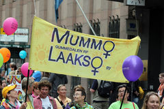 Participants of the gay parade carry banners and air balloons Royalty Free Stock Images