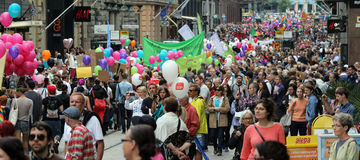 Participants of the gay parade carry banners and air balloons Stock Photos