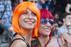 Participants at gay pride 2012 of Bologna. BOLOGNA - JUNE 9: smiling women with colorful wigs in the Bologna Gay Pride parade to support gay rights, on June 09 royalty free stock image