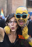 Participants at gay pride 2012 of Bologna. BOLOGNA - JUNE 9: young couple with colored face in the Bologna Gay Pride parade to support gay rights, on June 09 royalty free stock photos