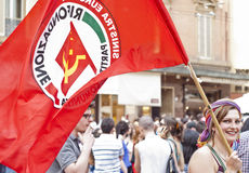 Participants at gay pride 2012 of Bologna. BOLOGNA - JUNE 9: girl waving a flag of Communist party at the Gay Pride parade to support gay rights, on June 09 royalty free stock photography