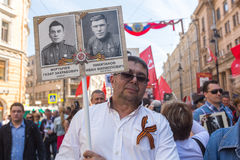 Participants of Immortal Regiment - public action, during which participants carried banners/portraits. St.PETERSBURG, RUSSIA - MAY 9, 2016: Participants of Royalty Free Stock Photography