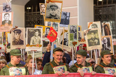 Participants of Immortal Regiment - public action, during which participants carried banners/portraits. St.PETERSBURG, RUSSIA - MAY 9, 2016: Participants of Stock Photo