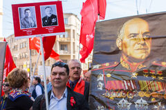 Participants of Immortal Regiment - public action, during which participants carried banners/portraits. St.PETERSBURG, RUSSIA - MAY 9, 2016: Participants of Stock Photography