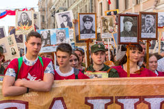 Participants of Immortal Regiment - public action, during which participants carried banners/portraits. St.PETERSBURG, RUSSIA - MAY 9, 2016: Participants of Royalty Free Stock Images