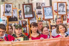 Participants of Immortal Regiment - public action, during which participants carried banners/portraits Stock Photos