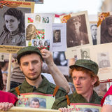 Participants of Immortal Regiment - public action, during which participants carried banners/portraits. St.PETERSBURG, RUSSIA - MAY 9, 2016: Participants of Stock Image