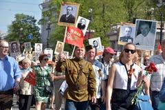 Participants of Immortal Regiment - public action, during which participants carried portrait Stock Photos