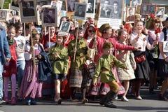 Participants of Immortal Regiment - public action, during which participants carried portrait Stock Images