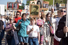 Participants of Immortal Regiment - public action, during which participants carried portrait Stock Photo