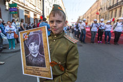 Participants of Immortal Regiment - public action, during which participants carried portraits of their relatives. St.PETERSBURG, RUSSIA - MAY 9, 2016 Royalty Free Stock Photo