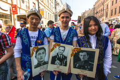 Participants of Immortal Regiment - public action, during which participants carried portraits of their relatives who participated Royalty Free Stock Photo