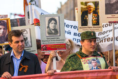 Participants of Immortal Regiment - public action, during which participants carried portraits of their relatives who participated Stock Photography