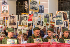 Participants of Immortal Regiment - public action, during which participants carried portraits of their relatives who participated Stock Images