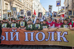 Participants of Immortal Regiment - public action, during which participants carried portraits of their relatives who participated Stock Photos