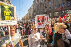 Participants of Immortal Regiment - public action, during which participants carried portraits of their relatives who participated Stock Photo