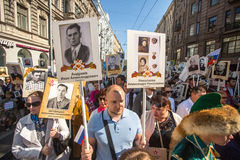 Participants of Immortal Regiment - public action, during which participants carried portraits of their relatives who participated Stock Image