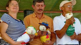 Participants of the international cuy food festival with Guinea pigs, Ecuador stock images