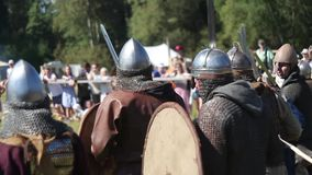Participants on international historical reconstruction of medieval culture, knights fighting. Moscow, Russia - August 08, 2015: Participants on international stock footage