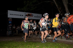 Participants kickstart early morning race Stock Photos