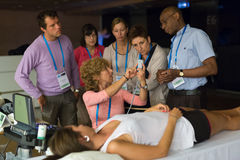 Participants learning new ultrasound techniques on medical congress. royalty free stock photography