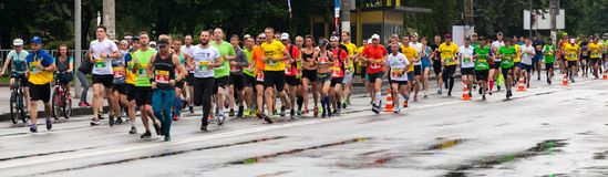 Participants of Marathon. Dnipro, Ukraine - May 20, 2018: Participants of INTERPIPE Dnipro Half Marathon running along the street royalty free stock photo
