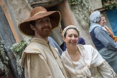 Participants of medieval costume party. Taggia, Italy - March 18, 2018: Participants of medieval costume party in the historic city of Taggia in Liguria region royalty free stock photography
