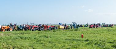 Participants of the oldtimer tractor tour preparing to start royalty free stock image