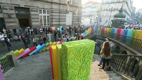 Participants of open air action the Domino Effect , in the centre of the old town stock video footage