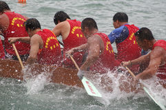 Participants paddle their dragon boats. TUEN MUN, HONG KONG - JUNE 16: Participants paddle their boats during a dragon boat race on June 16, 2010 in Tuen Mun Stock Photo