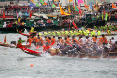 Participants paddle their dragon boats. TUEN MUN, HONG KONG - JUNE 16: Participants paddle their boats during a dragon boat race on June 16, 2010 in Tuen Mun Royalty Free Stock Image