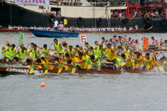 Participants paddle their dragon boats. TUEN MUN, HONG KONG - JUNE 16: Participants paddle their boats during a dragon boat race on June 16, 2010 in Tuen Mun Royalty Free Stock Images