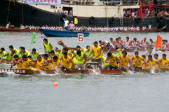 Participants paddle their dragon boats. TUEN MUN, HONG KONG - JUNE 16: Participants paddle their boats during a dragon boat race on June 16, 2010 in Tuen Mun Stock Photography