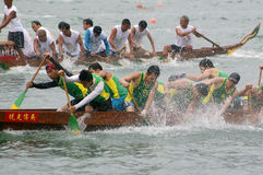 Participants paddle their dragon boats. TUEN MUN, HONG KONG - JUNE 16: Participants paddle their boats during a dragon boat race on June 16, 2010 in Tuen Mun Royalty Free Stock Photos