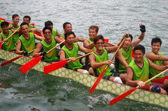 Participants paddle their dragon boats. TUEN MUN, HONG KONG - JUNE 16: Participants paddle their boats during a dragon boat race on June 16, 2010 in Tuen Mun Royalty Free Stock Photography