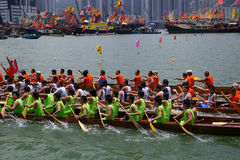 Participants paddle their dragon boats. TUEN MUN, HONG KONG - JUNE 16: Participants paddle their boats during a dragon boat race on June 16, 2010 in Tuen Mun Stock Photos