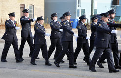 Participants of the parade marching down the street. Photo was taken during Canadian Remembrance Day ceremonies in Winnipeg City, Manitoba province, Canada. on royalty free stock photo