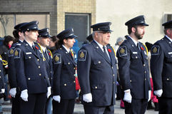 Participants of the parade marching down the street. Photo was taken during Canadian Remembrance Day ceremonies in Winnipeg City, Manitoba province, Canada. on stock photo