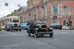 Participants of the parade of retro vehicle moving along Nevsky Prospekt. Saint Petersburg Royalty Free Stock Photo