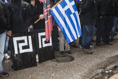 Participants of politcal rally with flags. Participants of politcal rally with greek flag and sign of political party Golden Dawn (Xrisi aygi Royalty Free Stock Photo