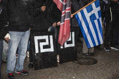 Participants of politcal rally with flags. Participants of politcal rally with greek flag and sign of political party Golden Dawn (Xrisi aygi Stock Image
