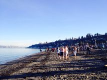 Participants Prepare To Do 2015 Polar Bear Plunge. January 01, 2015 - Seattle, Washington. People Take A Plunge Into Frigid Puget Sound Waters On New Years Day royalty free stock image